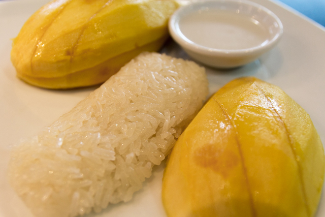 Ripe Mango served with Sweet Sticky Rice and Topped with Coconut Milk
